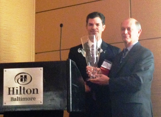 NASCIO President and Mississippi CIO Craig Orgeron presents the 2014 Technology Champion award to Dave McClure of the GSA.