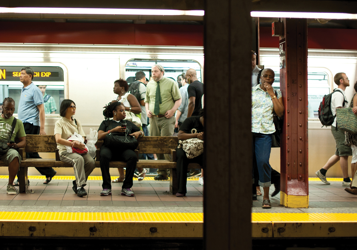 Commuters waiting on a New York City subway platform