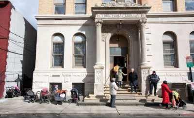 Strollers outside a Hoboken library