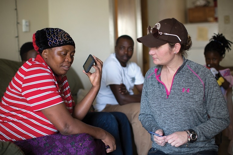 Congolese woman speaks to a refugee center caseworker