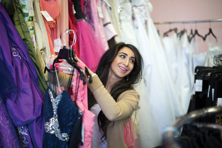 Liyah Babayan organizes dresses in her consignment shop in Twin Falls